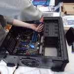 Securing the motherboard to the copper risers.